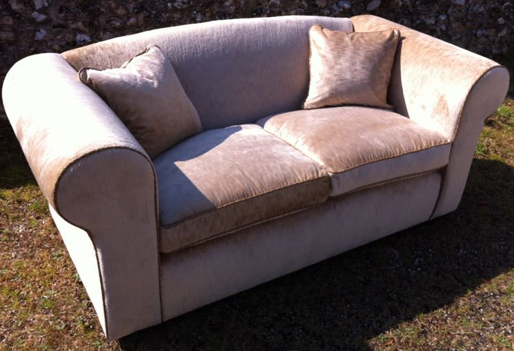 Beautifully reupholstered 2 seater sofa covered wtih Swaffers velvet